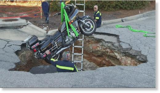 Motorcyclist falls into sinkhole