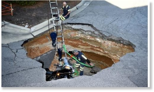 Man, motorcycle fall into Augusta Exchange shopping center sinkhole