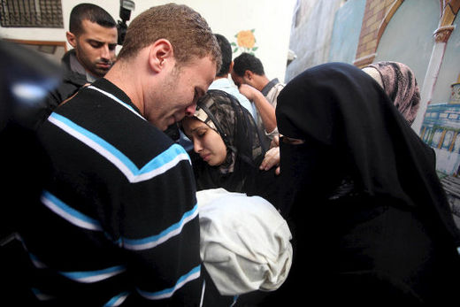 BBC Arabic picture editor Jihad Misharawi and his wife mourn during the funeral of their 11-month-old baby boy Omar, who was killed the previous day when an Israeli shell hit their Gaza City home, 15 November