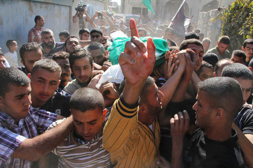 Mourners carry the body of a fighter killed in an Israeli airstrike during his funeral in the Gaza Strip town of Khan Yunis, 28 October