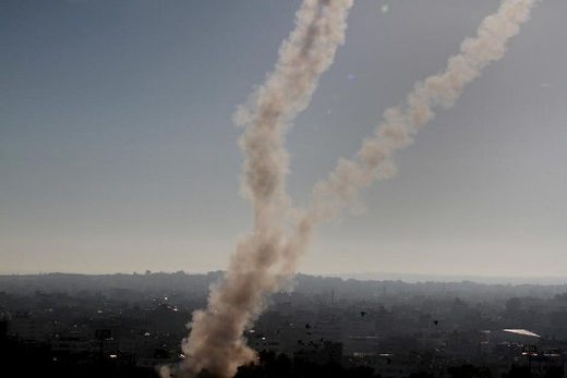Smoke trails from rockets launched by Palestinian fighters in Gaza towards Israel are seen over Gaza City, 15 November