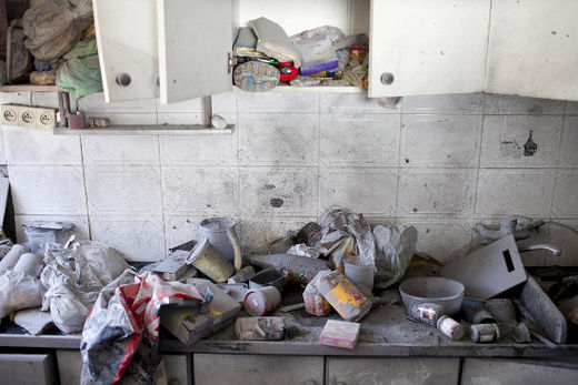 A destroyed kitchen inside a Kiryat Malachi house where three Israelis were killed when it was hit by a rocket fired from Gaza, 15 November. It was the first fatal rocket fired from Gaza so far this yea