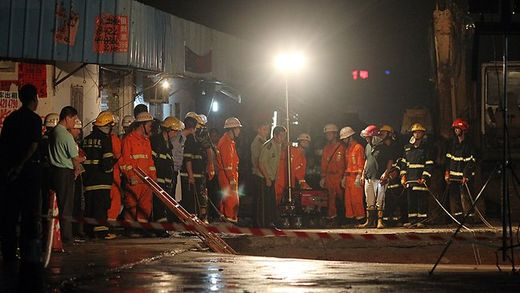 Rescuers are continuing the search in China for those buried in the cave-in with authorities still unsure about how many people fell in the hole