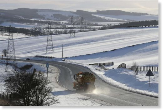 A gritter lorry on the A68 in the Scottish Borders. Police have advised motorists to drive with extreme caution amid wintry conditions.
