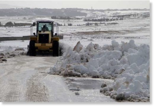 Local authorities clear a road blocked by snowfall in Tunisia on January 25, 2019