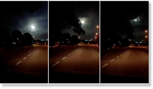 A fiery ball of light plummets through the sky as seen from Johor Bahru, Malaysia, in a dashboard camera recording.
